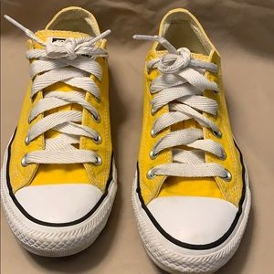 Bright yellow low top converse